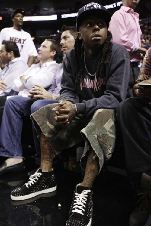 Lil-Wayne-BBC-hat-neiman-marcus-sweater-marc-by-marc-jacobs-camo-shorts-christian-louboutin-sneakers