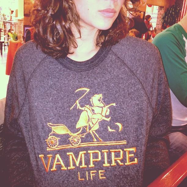 girl-wearing-vampire-life-headless-horsemen-hermes-sweater