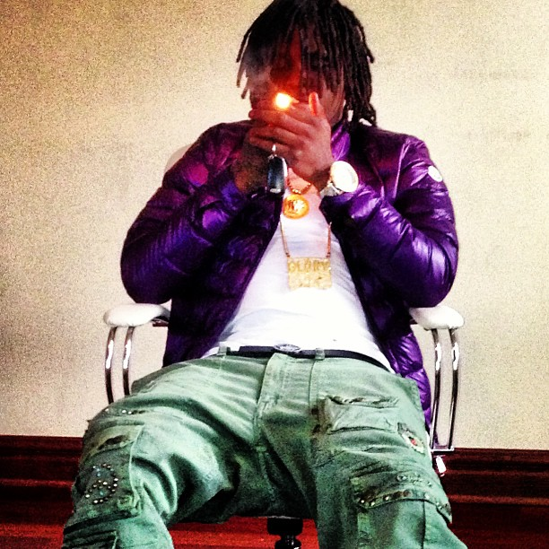 chief-keef-versace-belt-robin-jeans-cargo-pants-moncler-purple-jacket