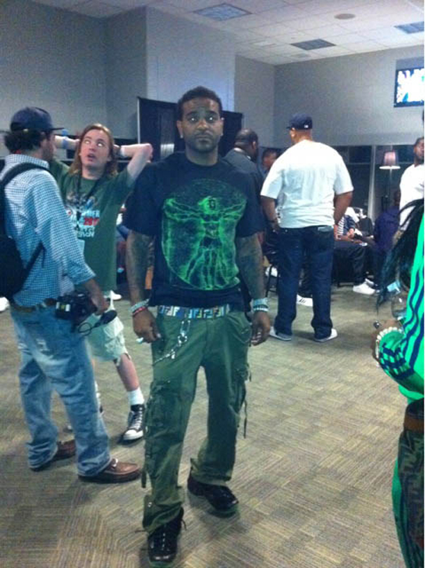 Jim Jones Wearing Nike Air Foamposite One Black/Electric Green On Feet