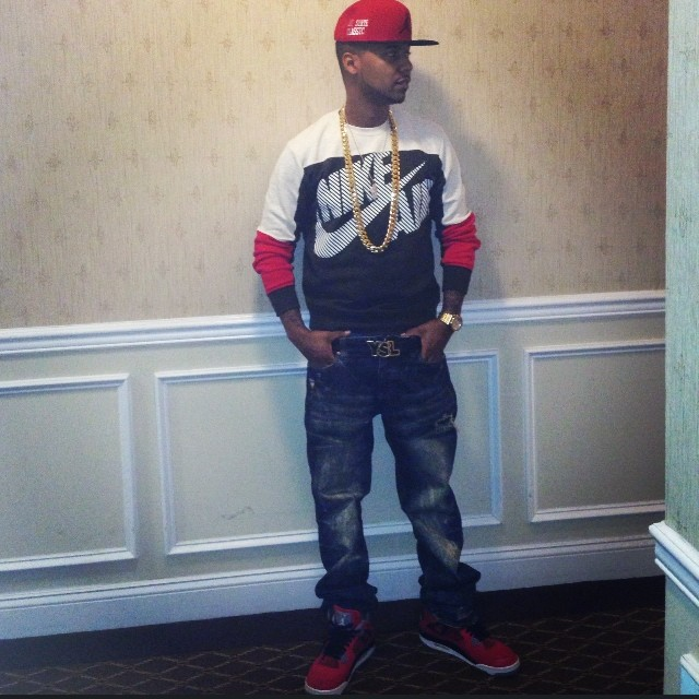 juelz-santana-nike-air-crew-sweatshirt-ysl-logo-plaque-buckle-belt-air-jordan-4-fire-red-toro-bravo-on-feet