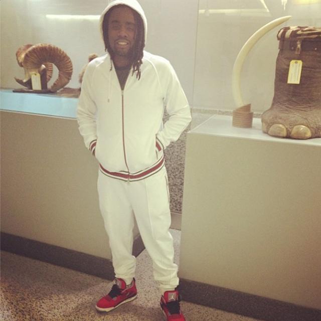 ab4a5032175109 Wale wearing Gucci Sweatsuit and Air Jordan 4 Toro Bravo On Feet ...