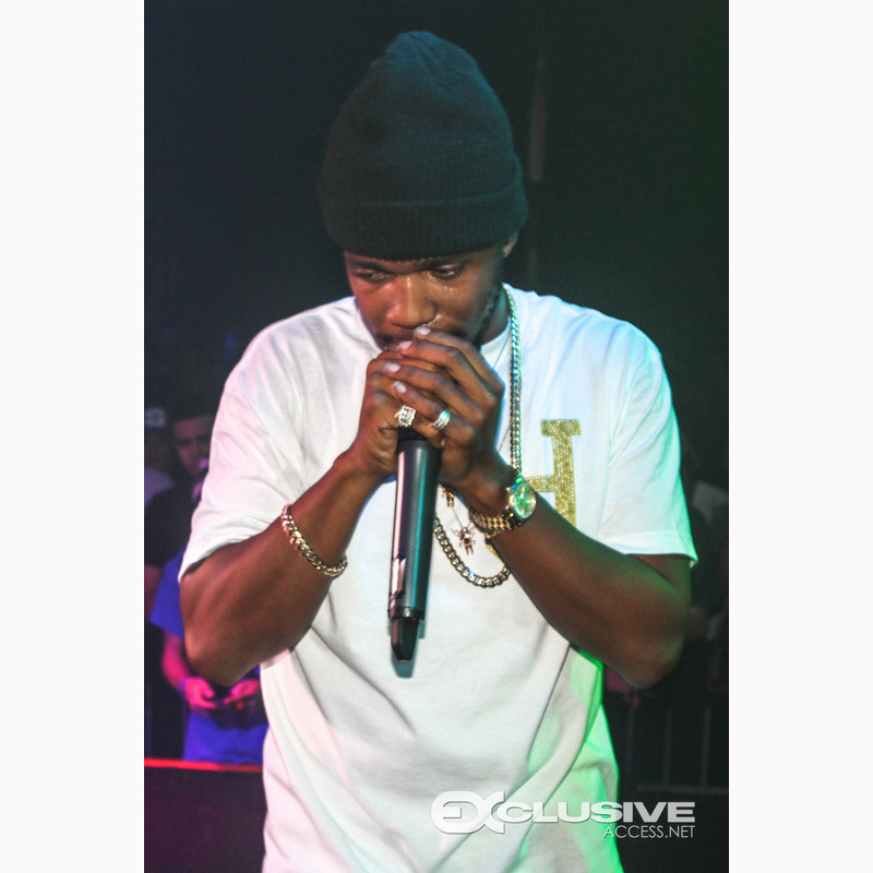 curren$y performing wearing diamond supply un polo ben baller shirt and rolex day date president watch