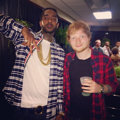 Nipsey-Hussle-wearing-Thom-Browne-plaid-oxford-cloth-shirt-versace-belt-Backstage-with-Ed-Sheeran-thumb