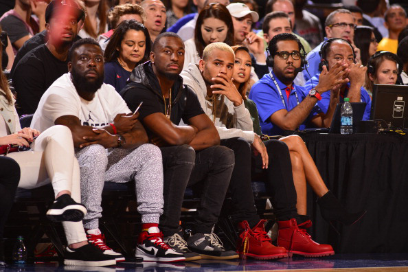 chris-brown-karrueche-tran-bee-line-timberland-red-boots-on-feet-usa-basketball-game