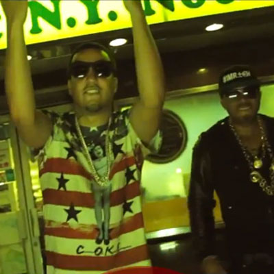 "382dcba835e French Montana wearing Coke Boys American Girl Shirt in Red Cafe s ""Im  Rich"" Video"